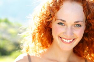 Smiling woman with beautiful teeth thanks to the cosmetic dentist modesto loves